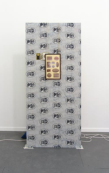 David Raymond Conroy, Broadway Flat (for Laurie Parsons) & The Contortionist, Dutch wax fabric, stretcher, brass picture chain, book page, mount mat, frame, 240 x 110 x 80cm. A new work kindly donated by the artist and Seventeen.