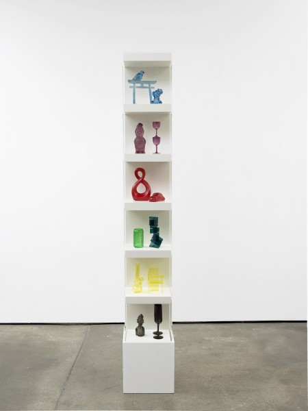 Image: Matthew Darbyshire, Untitled: Accessorised Column No. 5, 2012. Various plastic, glass, and resin components, shelving units, and perspex case, 215 x 30 x 30 cm. Courtesy the artist and Herald Street, London.