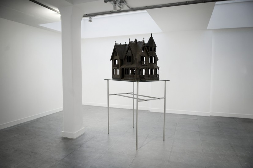 House, 2008, wasp nests, steel and glass base 235 x 125 x 100cm. After emerging from hibernation during early spring, the young queens set in to motion the construction of a colony. Wood fibre is collected from the surrounding area, mixed with saliva, and chewed to a pulp from which the nest is made. In the autumn, as it becomes colder, the colony dies leaving only the young queens to hibernate underground and the nest empty. Abandoned nests are not reoccupied. The co-ordinates of a wooden dolls house kit have been copied, and the structure replicated from sheets made of approximately 300 pulped paper wasp nests. © the artist, courtesy the artist and All Visual Arts.