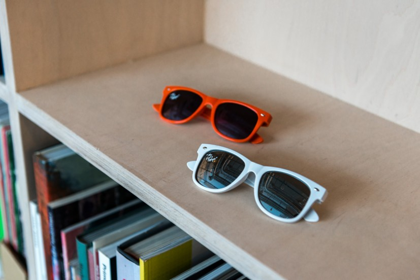 David Steans, The Lucky and Unluky Eskape (Sunglasses), 2013, clear printed vinyl sticker on a unit of 2 pairs of coloured sunglasses (colours vary but always differ between pairs), edition of 5 + 1 A/P, 47 x 138 x 148mm. Courtesy of the artist. Photo: Joe Plommer