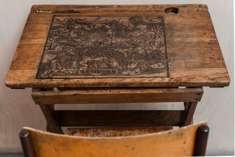 Iain Andrews, Mythopoeia - The Judicivator, 2011, etching on found wooden desk, 65 x 42 x 70cm. Courtesy of the artist and Man&Eve. Photo: Joe Plommer
