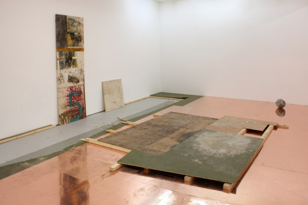 Oscar Murillo, the problem of digesting something that's bigger than you can handle? #1, 2013. Plywood, flooring, copper, and 4 bingo paintings. Dimensions Variable, Paintings: 32 1/4 x 31 1/2 inches (82 x 80 cm). Courtesy David Zwirner, New York/London