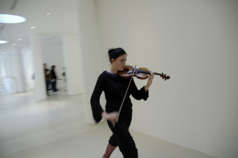 Violin Siren, performance from Do Not Interrupt Your Activities, Royal College of Art, London, 2005. Violinists are asked to write a score emulating the sound of the local emergency vehicle siren. The violinists play their score live whilst moving around the exhibition as quickly as possible, 2005-ongoing, ©  the artist