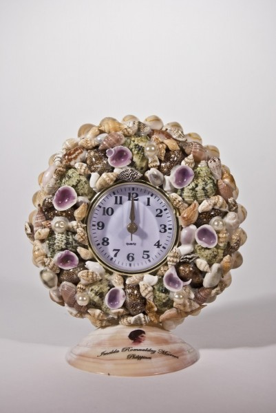 Pio Abad, Seashell decorated desk clock featuring the profile and insignia of Imelda Marcos given to and promptly rejected by my father as a Christmas present in 2010, 2012, seashells, adhesive, desk clock, 16.5 x 3.5 cm x 8 cm, unique, courtesy the artist