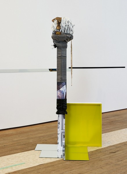 Wish List, 2013, wood, photocopies, bootleg stonewash grey jeans, knee-high leather boot cuff, paint, ceramic, backless gold top, resin, enamel, print, talc, mirror, chain, MDF, 172 x 65 x 80cm. Photo: Anna Arca, © the artist
