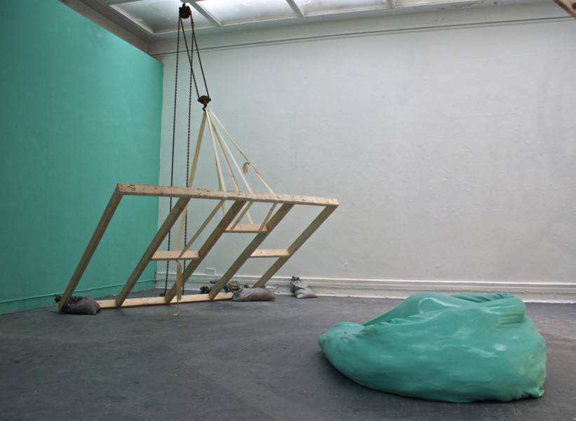 Colour Complement to Haemoglobin, 2013, timber, builder's block and tackle, rubber strips, painted sandbags, green emulsion paint, latex, plaster, wadding, steel, © the artist