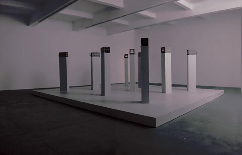 "Cult, 2002, installation with nine 9"" monitors, plinths, podium, ramp, DVD players, podium size 600 x 600 cm. DV on DVD: 45 minutes on continuous loop. Commissioned by Chisenhale Gallery"