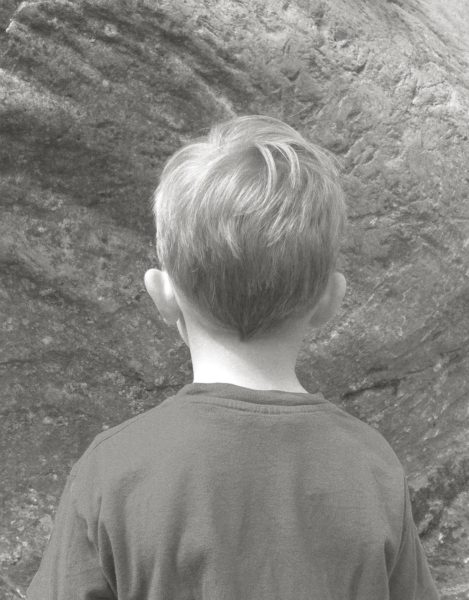 Boy looks at Rock on Top of Another Rock , 2017, Archival pigment print, 45 x 35 cm.  Image courtesy the artist, © the artist.