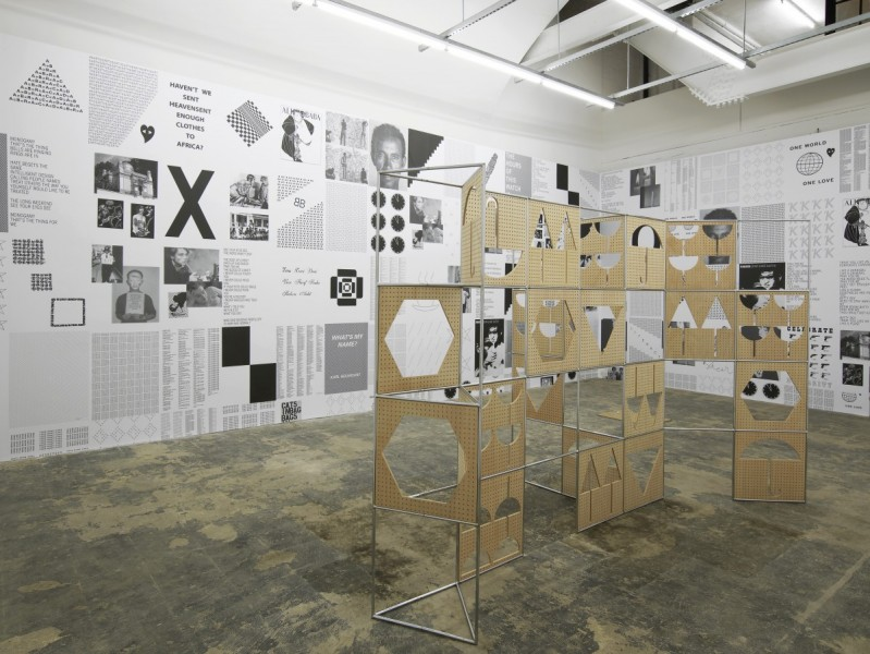 HOUSE (installation view), 2014. Karl Holmqvist, Give Posters a Try, 2013, A1 size wallpaper; Belén Uriel, Manual, 2012, nickel-plated tubular modular steel structure and okume drilled wood panels, 200 x 350 x 100cm. Photo courtesy Hollybush Gardens, London