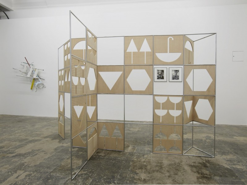 HOUSE (installation view), 2014. Anna Fasshauer, Serotonin, 2013 various found objects, cement, laquer, 135 x 90 x 38 cm; Belén Uriel, Manual, 2012, nickel-plated tubular modular steel structure and okume drilled wood panels, 200 x 350 x 100cm; Belén Uriel, Good Companion Rooms (old and new side by side), 2011 inkjet photographs printed on cotton paper, 45 x 40cm each. Photo courtesy Hollybush Gardens, London