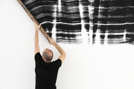 Ferran Gisbert wields a handmade paintbrush corresponding to his own height. From Performed Painting:  Rosana Antolí, Ferran Gisbert, Alan Sastre and Vicky Uslé. Image courtesy the artist and The Ryder, London, 2015.