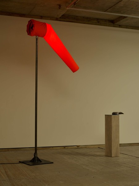 Fiona Banner, Agent Provocateur, 2015, Heart of Darkness magazine, plinth with graphite, fabric windsock, electrically powered fan, LED light, mixer and stand, 3 x 32.4 x 24.4cm (magazine), 110 x 32 x 24.4cm (plinth), 330 x 183 x 30cm (windsock). Image courtesy the artist and Frith Street Gallery, London. Photo: Stephen White