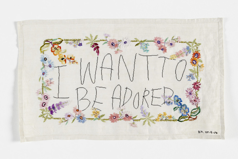 I Want to be Adored, antique embroidery with cotton silk cross stitch, 33 x 58cm, 39 x 63cm framed, 2014. Image courtesy the artist. © the artist