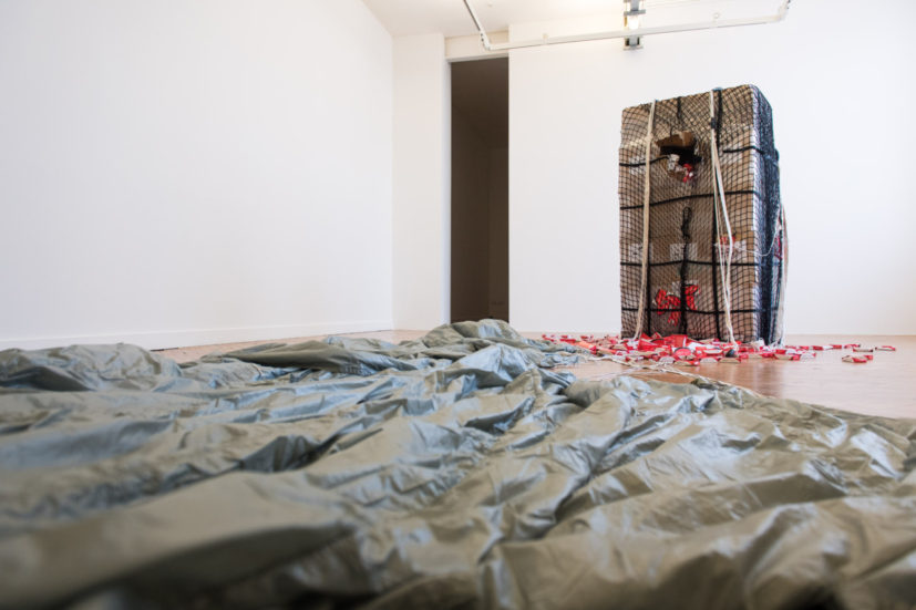 Nástio Mosquito,Transitory Suppository: Act #II No.Pruritus. No. Ani, 2016. Cardboard boxes with plastic packaging, leaflet, poster and parachute. Dimensions variable. Artes Mundi 7 installation view, Chapter, 2016. Courtesy the artist. Photos Polly Thomas.