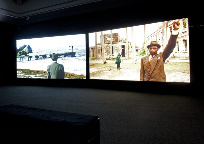 John Akomfrah, Auto Da Fé, 2016. Two channel HD. colour video installation, 5.1 sound 40 minutes 30 seconds. Artes Mundi 7 installation view, National Museum Cardiff, 2016. ©Smoking Dogs Films. Courtesy the artist and Lisson Gallery, London. Photo Jamie Woodley