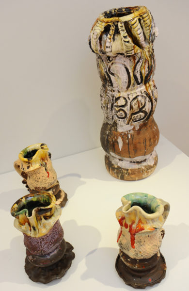 Simon Carroll, Tall vase, 2006 and Three jugs, 2007. Slip-painted earthenware with coloured glazes