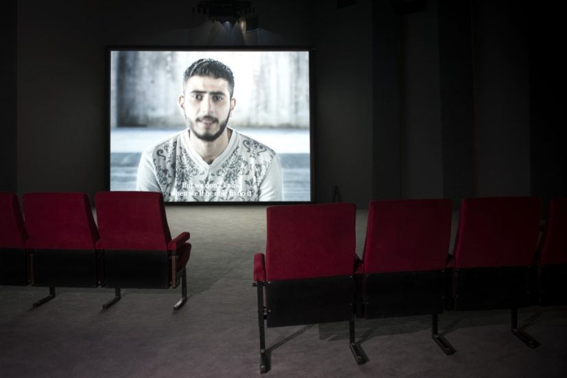 "Bouchra Khalili, The Tempest Society, 2017, digital video, installation view, Athens School of Fine Arts (ASFA)—Pireos Street (""Nikos Kessanlis"" Exhibition Hall), documenta 14, © Bouchra Khalili/VG Bild-Kunst, Bonn 2017, photo: Angelos Giotopoulos"