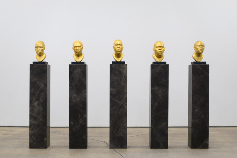Thomas J Price, Untitled (Icon 1-5) group view, 24 ct gold leafed aluminum composite, Italian slate base on quartzite plinth, 2017. Image courtesy of the Artist and Hales Gallery. Copyright the Artist.