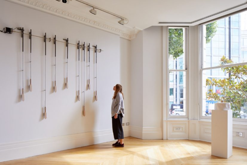 Pascal Hachem, left under, 2017. Wooden brushes, metal structures, step motor and electrical board. Photograph by Andy Stagg, image courtesy of The Mosaic Rooms.