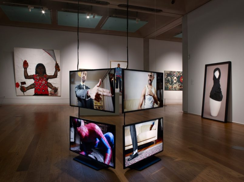 Installation view of 'Speech Acts' at Manchester Art Gallery. Works: Sutapa Biswas, Housewives with Steak Knives, 1985-86; Hetain Patel, The Other Suit, 2015; Lubaina Himid, The Tailor, 2010; Yara El-Sherbini, Skit, 2018; Alan Davie, Elephant's Eyeful, 1960.