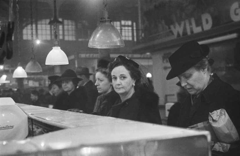 Roman Vishniac, 'Customers waiting in line at a butcher's counter during wartime rationing, Washington Market, New York, 1941-44'. © Mara Vishniac Kohn, courtesy International Center of Photography. On display at The Photographers' Gallery