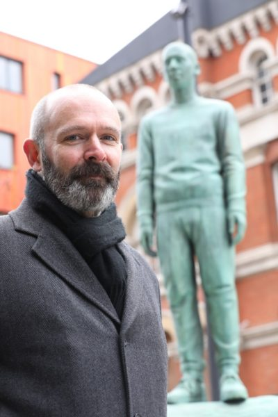Kenny Hunter in front of the Southwark Memorial, 2018, Walworth Square, London. Image courtesy of Southwark Council